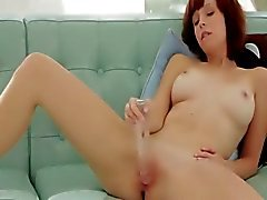 Huge glass toy in redheads pussy