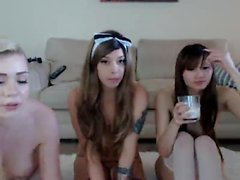 Three irresistible young girls strip off their clothes for