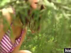 Solo brunette girl fingers her pussy outdoors