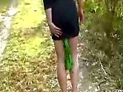Huge anal vegetable hidden in her ass in a public forest