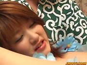 Mai pulls her panties a side and gets fingered and dildoded