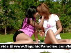 Gorgeous redhead and brunette lesbians kissing and fingering pussy and having lesbian love
