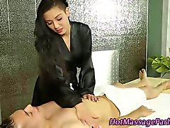Brunette masseuse feels up her client