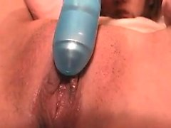 Amateur cam girl plays with her wet pussy close up
