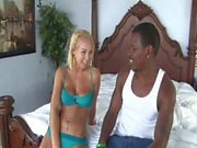 Young blonde in sexy lingerie having interracial sex