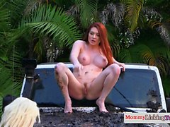 Busty redhead cougar licked outdoors by teen