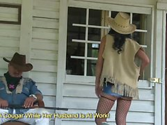 Nasty cowgirl showing her huge boobs