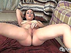 Flexible brunette Lou fingering her shaved pussy