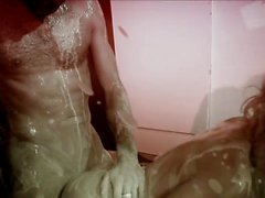 Blondie rides guy's dick in a bath filled with milk