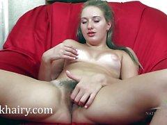 Brunette exposes her ass