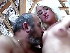 Young blonde beauty with glasses sucks nasty grandpa