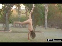 Attractive teen cutie working her naked body outdoor