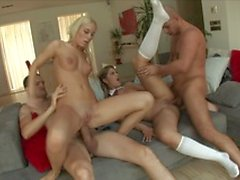 Two guys with big dicks love to fuck two young sluts with perky tits