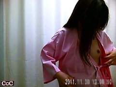 Spycam shows young brunette with tiny tits putting on a bla