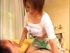 Asian teen with nice boobs squeezes them and rides his face