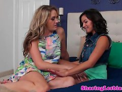 Busty babe licks and fingers young lesbian