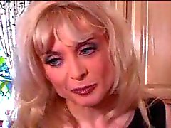 Nina Hartley fucks a teen with a strapon