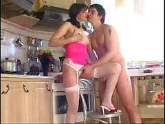 Young dude fucks with russian milf brunette at kitchen