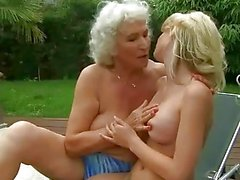 Horny busty granny fucks young blonde