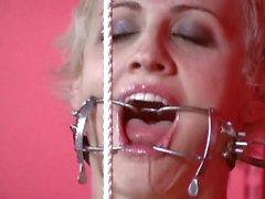 Masochist babe has her hands tied up while being fucked by dildo