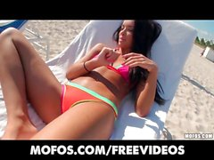 Sun tanning bikini babe has her wet pussy penetrated