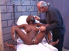 Young black girl is restrained, then clamped up before speculum inspection