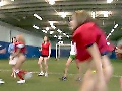 College teens pusslick on football field