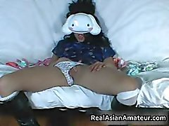 Masked Asian whore masturbates for part2