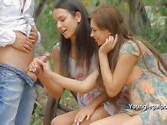 Guy fucks tight assholes of two ladies outdoor