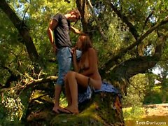 Horny couple enjoying outdoor sex in the forest