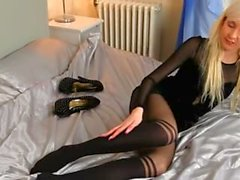Blonde babe in high heels finger on bed