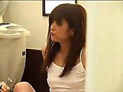 Beautiful Oriental teen has a horny masseur caressing her h