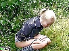 Young amateur blonde chick sucks huge boner outdoors
