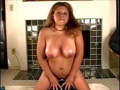 Busty cutie rides her sybian to a delicious orgasm
