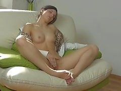 Young brunette fondles and spreads her pussy lips