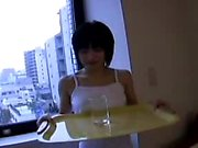 Enchanting Japanese teen with a pretty smile reveals her ti