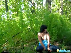 Sexy brunette teen strips in the woods