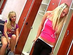 Young lesbians having joy in locker room