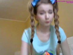 Cute small teen masturbates on webcam