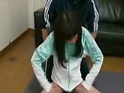 Athletic Asian teen with a pretty smile has a guy caressing