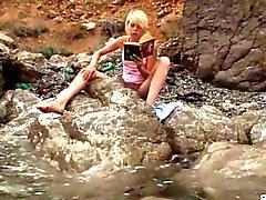 Kinky blonde teen teases by the sea