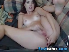 Cute Brunette fingering very fast her clit