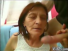 Grandma slut takes off false teeth to suck cock
