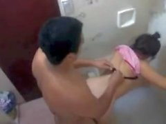 Voeyur catches Brazilian girl getting fucked in a public toilet