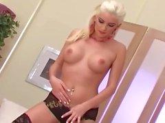 Pretty blonde stripping in black thigh high