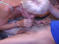 Mature blonde chick gets two stiff young cocks to play with sucking and riding them