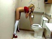 Teens fucks dildo in a toilet