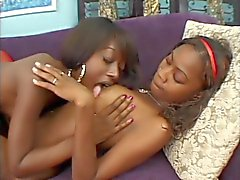 Two cute young black lesbians love to lick pussy and play with vibes and dildo