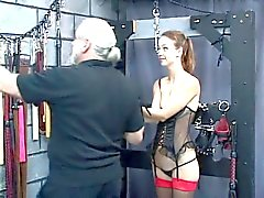 Sexy young slave gets her arms bounded above her head and gets punished