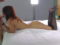 Young redhead in lovely stockings fucked by the porn casting guy